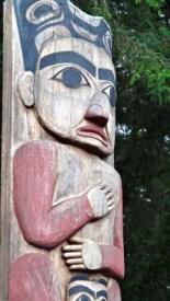 A close-up photo of a Totem pole in Sitka, Alaska