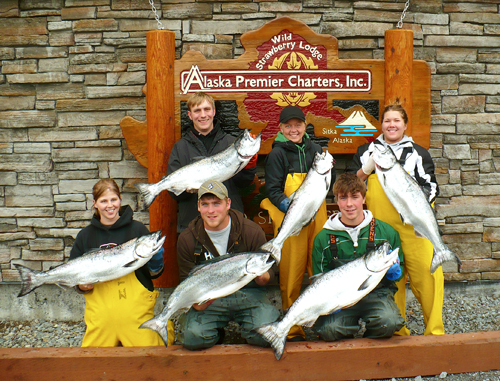 Staff Group Salmon in Front of the Lodge's Sign