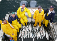 A group of our clients with a fine catch of silver salmon in Alaska