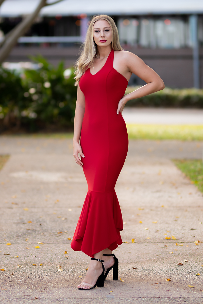 Alluring halter neck dress emphasising graceful lines about the neck, shoulders and back. Carefully sculpted, long continuous panels follow your figure, ending in a striking mermaid peplum. An amazing red carpet, night to remember dress.
