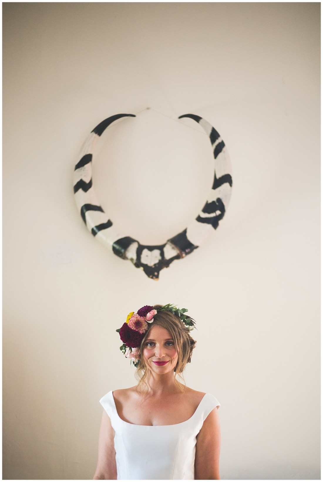 Portrait of a bride under Antlers - Wild Things Wed Photography