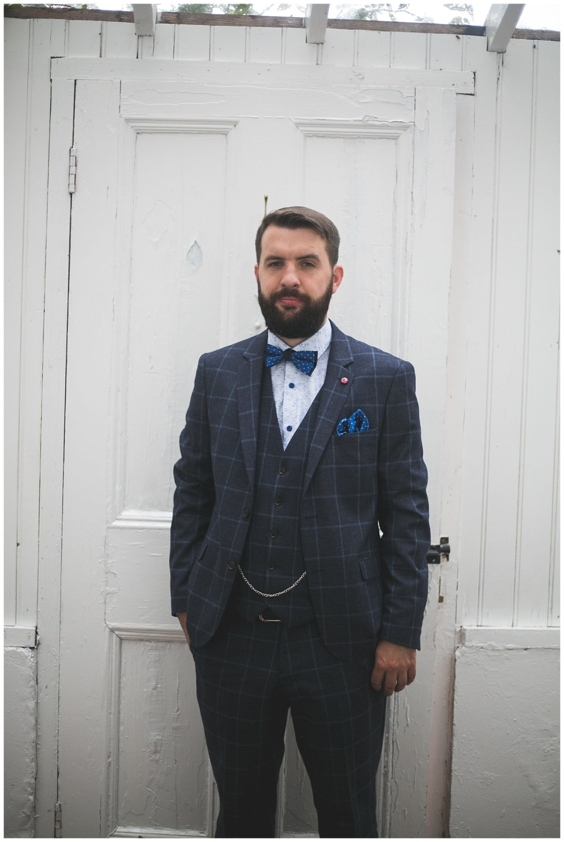 groom in a three piece blue suit