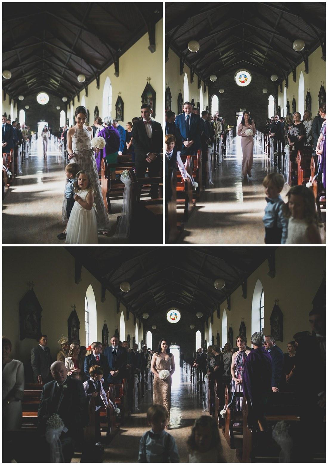Bridesmaids walking down the church aisle