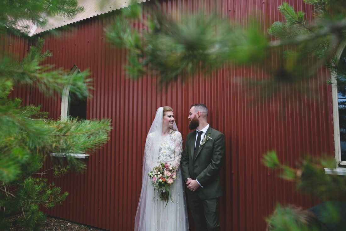 Red tin chapel with bride and groom at mount druid