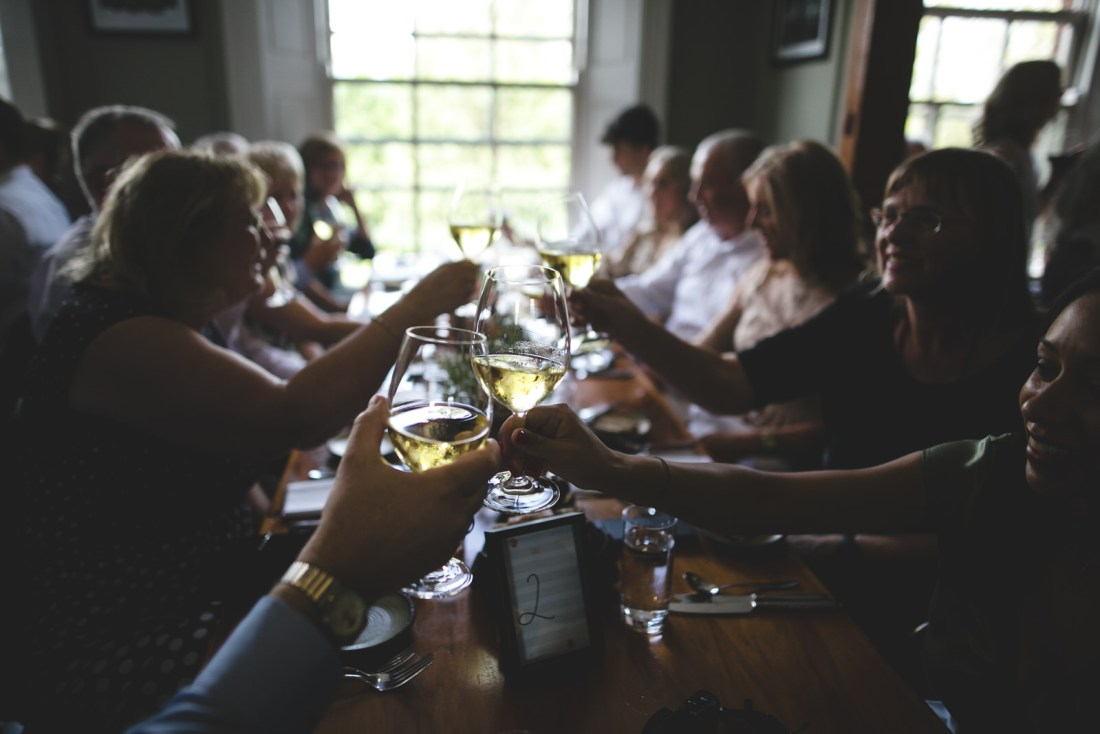 Wine glasses clinking during a wedding toast