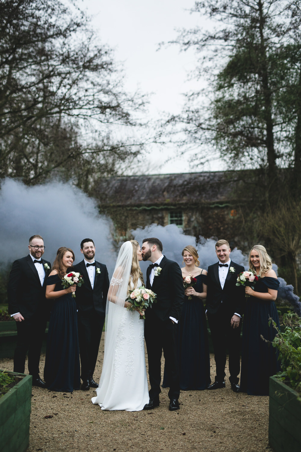 Smoke bomb wedding portrait in The village at lyons