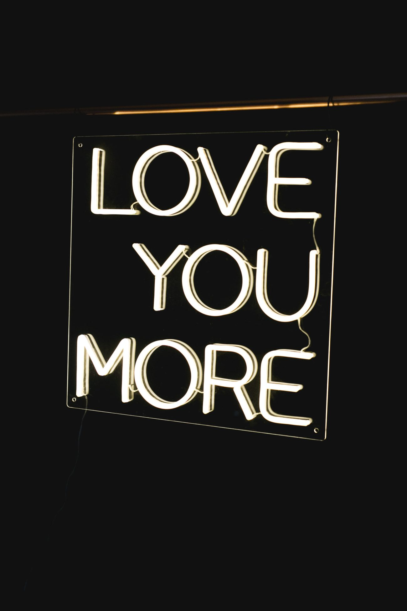 Love You More Neon sign to rent from Wild Things Wed