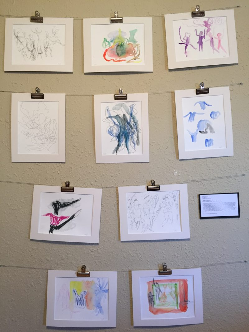 My installation of ten sketches, matted and mounted with clips on wire.