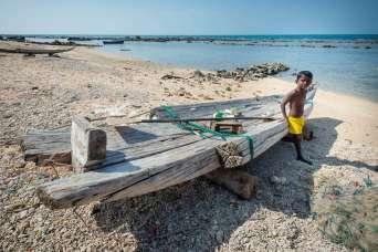 boy at beach Point Pedro Sri Lanka