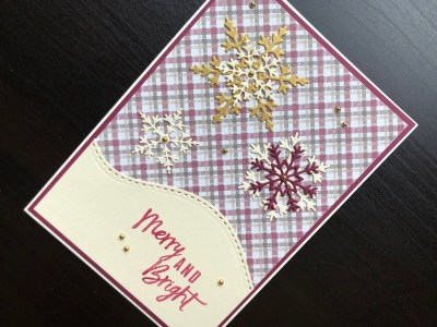 Merry and Bright Christmas card with die cut snowflakes on a tartan background