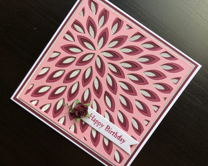 Hand made birthday card with layered die cutting and paper rose embellishment