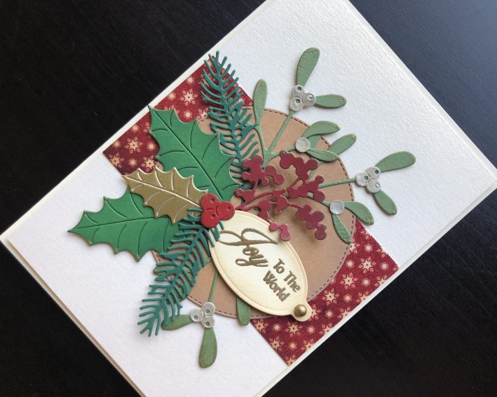 Hand made Christmas card with die cut winter foliage