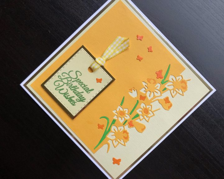 Hand made spring birthday card with die cut daffodil border