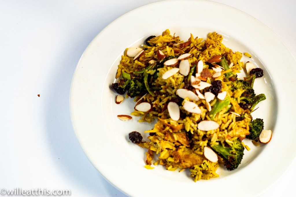 Curry Chicken and Broccoli Fried Rice with raisins and almonds