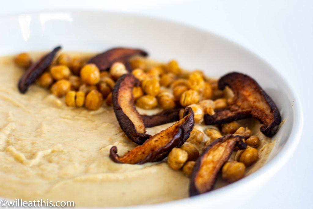 Crispy mushroom slices and crunchy chickpea on cauliflower and parsnip soup