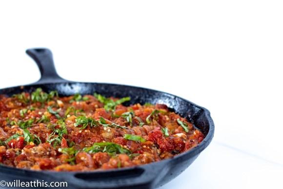 Tomato Eggplant Sauce in a black cast iron pan.