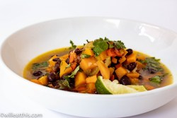 Butternut squash soup with black beans in a white bowl