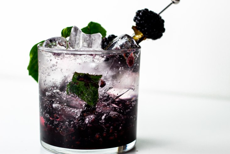 Blackberry Jalapeno Smash in a glass with ice.