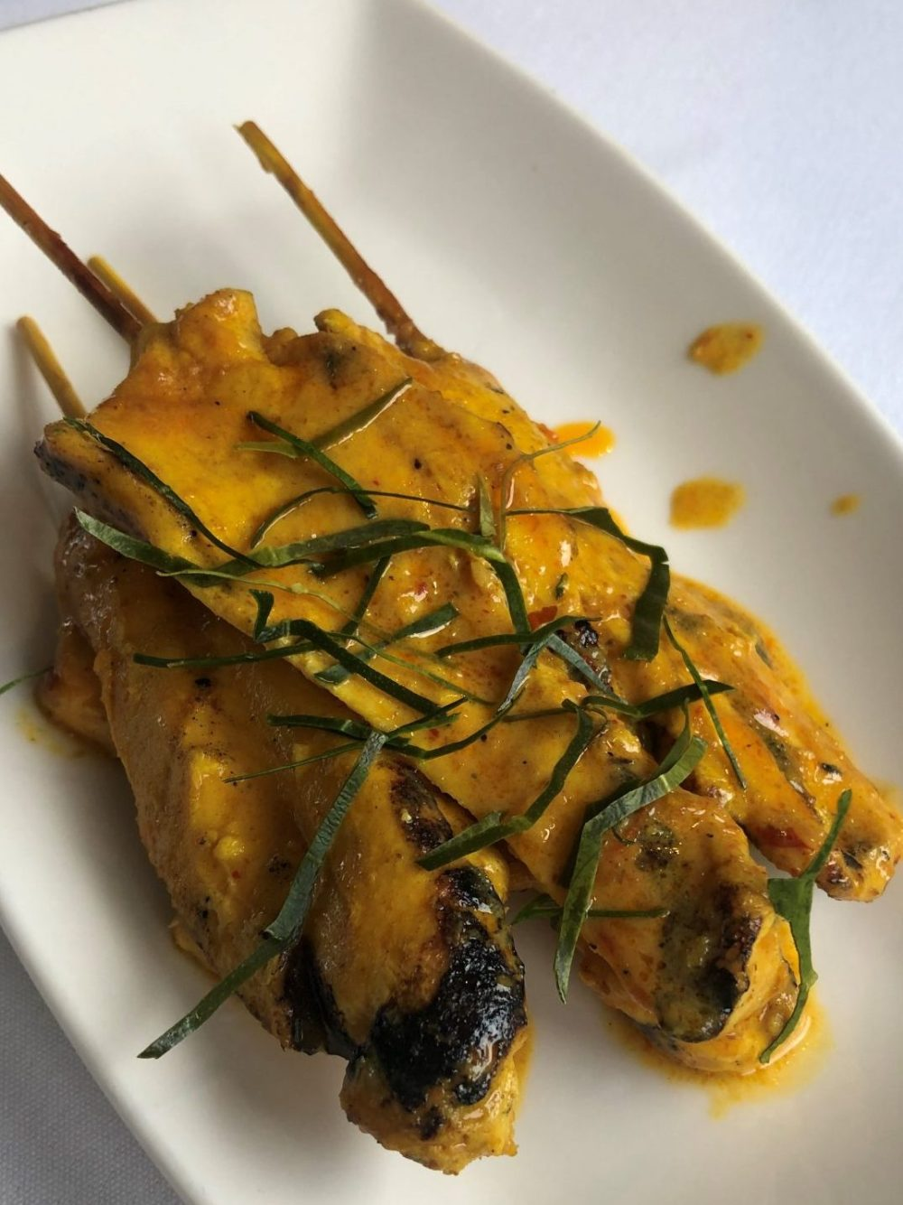Chicken Satay Peanut on skewers, East Restaurant Peterborough