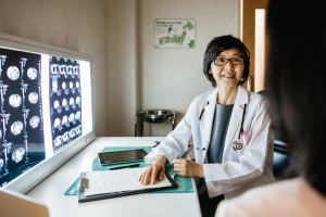 Female japanese doctor talking to a patient