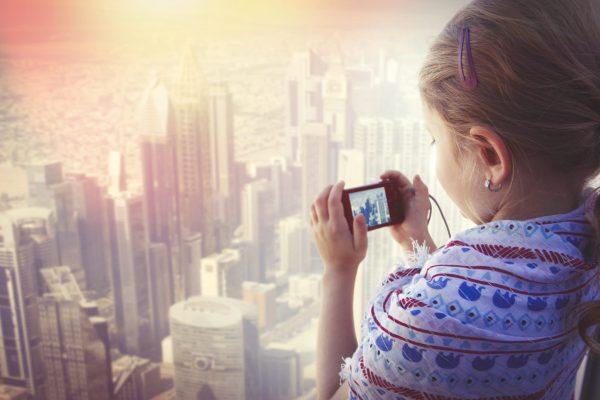Girl taking photo of the skyscrapers in Dubai city