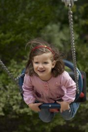 preschool child on swing