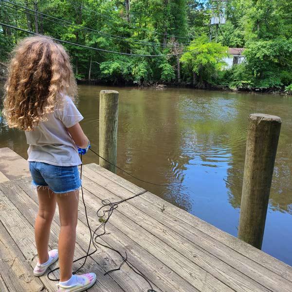 magnet-fishing-off-dock