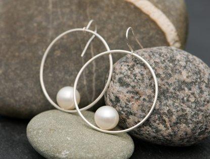white pearl hoop earrings in silver
