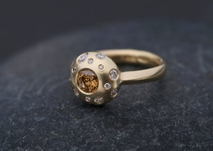 brown diamond multi-stone ring with small white diamonds