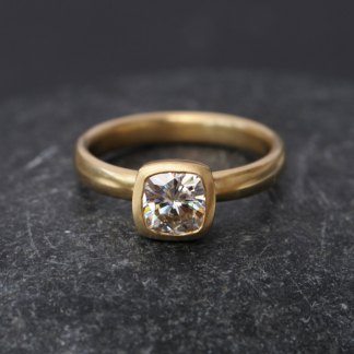 moissanite cushion cut engagement ring in recycled gold