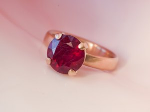 Natural ruby solitaire claw set in gold ring