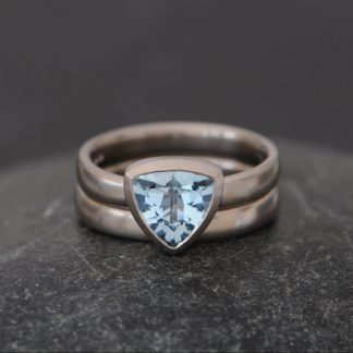 Aquamarine trillion set in white gold with white gold wedding band