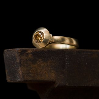 Brown diamond engagement ring set in 18k gold. By William White