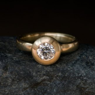 Beautiful and simple diamond ring, set in satin finished 18k Yellow Gold. By William White