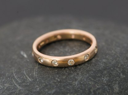 18k rose gold eternity ring set with moissanite stones