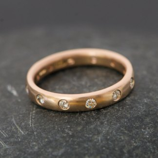 18k rose gold eternity ring set with moissanite stones