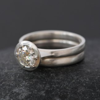 moissanite engagement ring and wedding band in silver