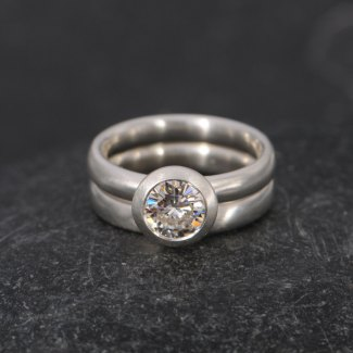 Forever Brilliant Moissanite ring in silver with matching wedding band