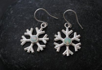 Magical looking Opal snowflake earrings, set in sterling silver. Very pretty snowflake earrings designed and handmade by William White in Cornwall, UK