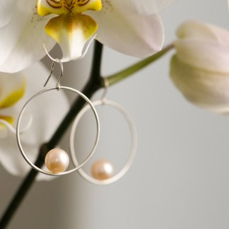 Peach pearl hoop earrings in silver. By William White