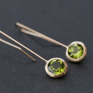 Beautiful green peridot and gold 'Lollipop' earrings. Apple green peridot set in 18k yellow gold. Designed and handmade by William White in Cornwall, UK