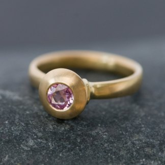 pink sapphire solitaire in gold ring