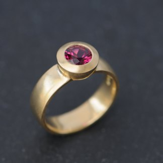 Deep pink tourmaline set into 18k yellow gold ring, by William White