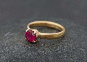 pink ruby solitaire claw set in gold ring