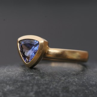 Purple blue trillion cut tanzanite set in 18k gold ring. By William White