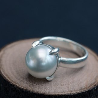 Large white south sea pearl claw set in silver ring