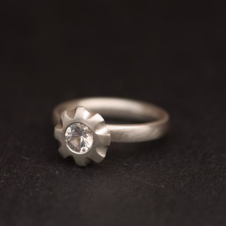 white topaz flower ring in satin finished silver