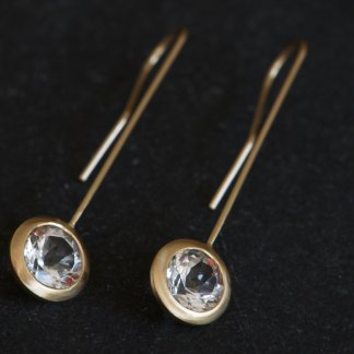 Clean and simple gold and white topaz 'lollipop' earrings. Sparkly white topaz set in 18k gold. Designed and handmade by William White in Cornwall, UK