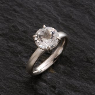 white topaz claw set ring in silver