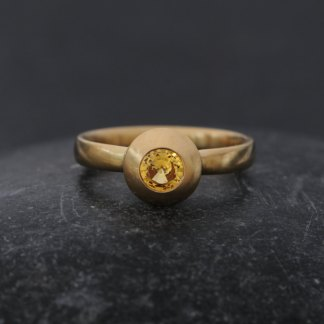 yellow sapphire solitaire set in 18k gold ring